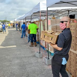 Office Systems team member volunteering at the food bank