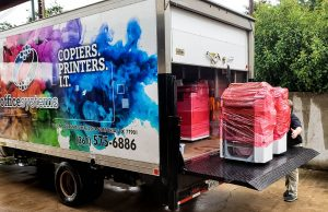 Printers and Copiers being unloaded off a truck