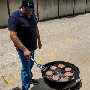 Office Systems team member making hamburgers